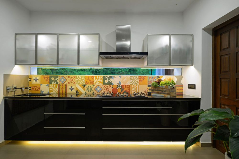 Highlight a wall one-wall kitchen with a funky backsplash and some accent lighting