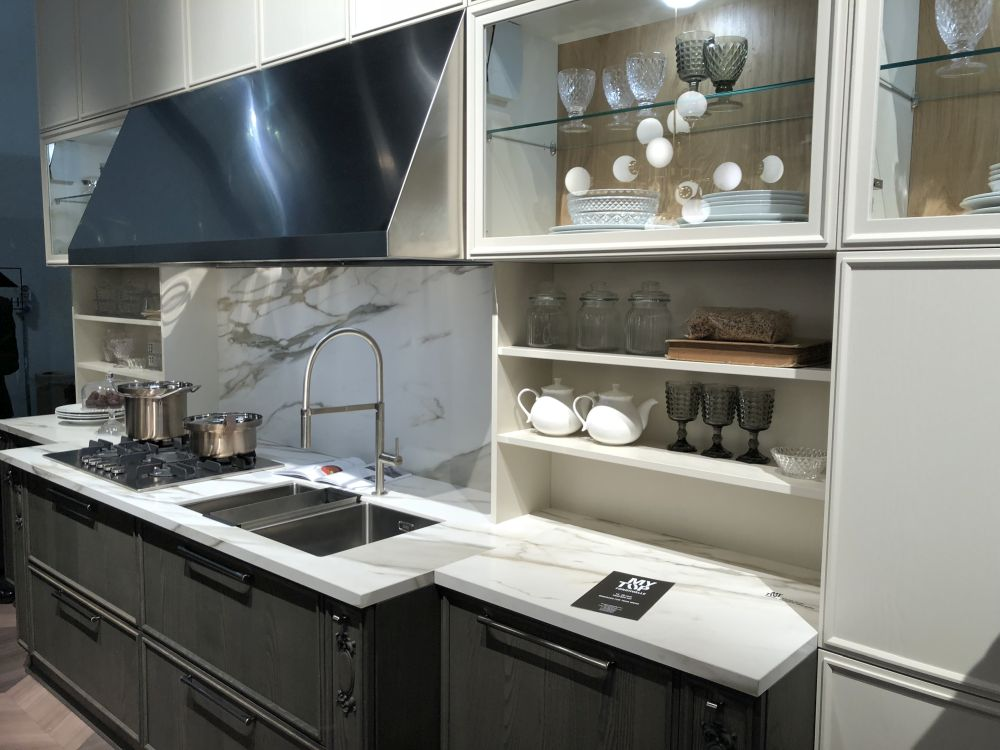 Add open shelves or shallow backsplash cubbies to maximize storage in a one-wall kitchen