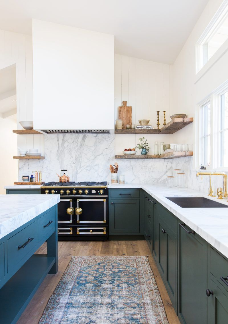 Pair wooden shelves with a marble backsplash