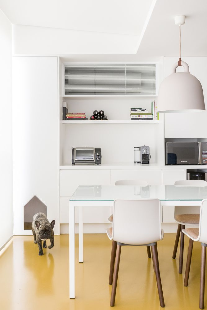 The kitchen and dining area are seamlessly connected and feature a white-based palette