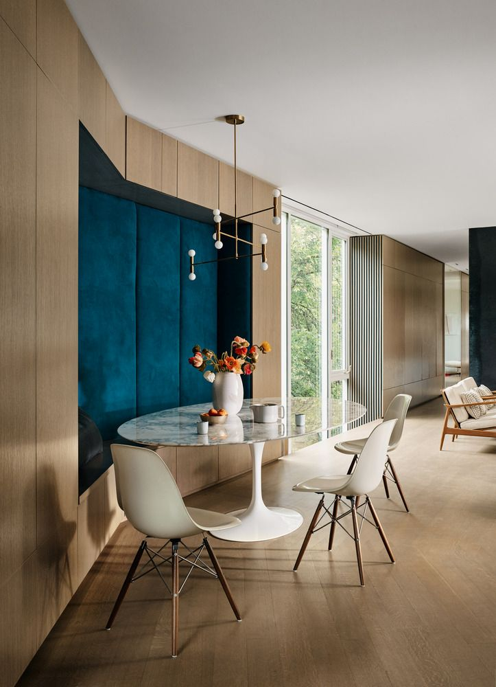 The dining area is part of an open space but has its own cozy seating nook