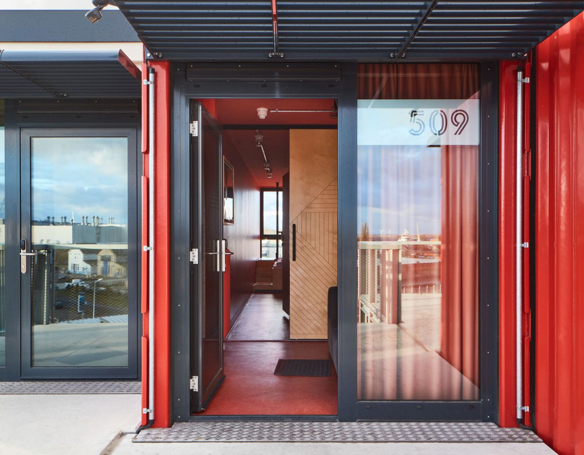 The overall style of this container hotel is a blend of modern and industrial with a casual and friendly aura