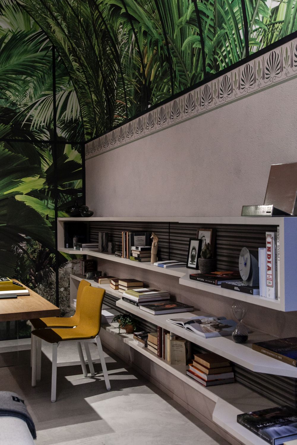 Long, horizontal bookcases can put an emphasis on a room's overall size and layout