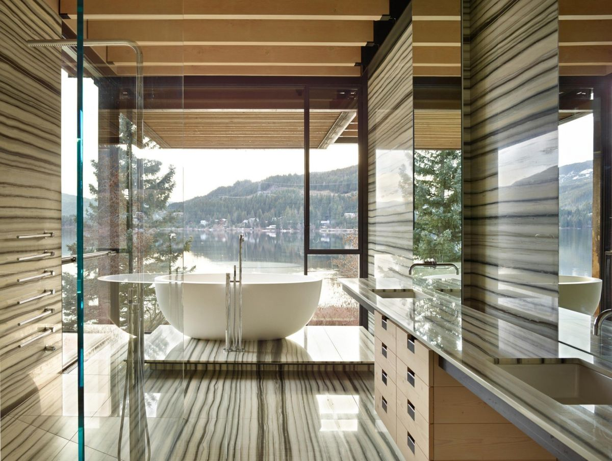 The design of the bathroom emphasizes the tub and view.