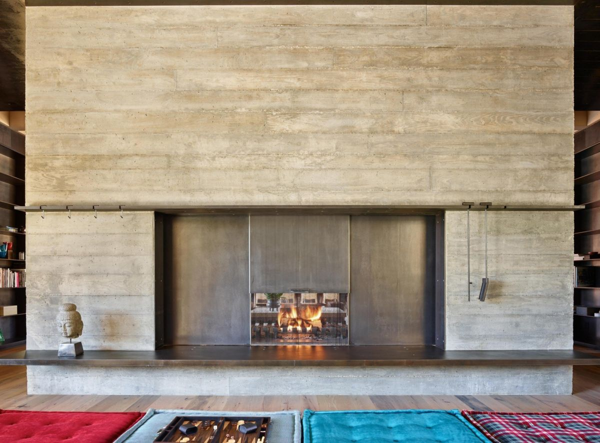 A panel can be lowered to make the fireplace opening even smaller.