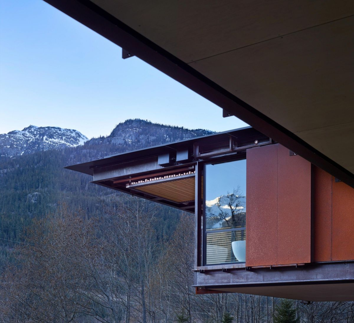 Large windows offer views of the surrounding mountains.
