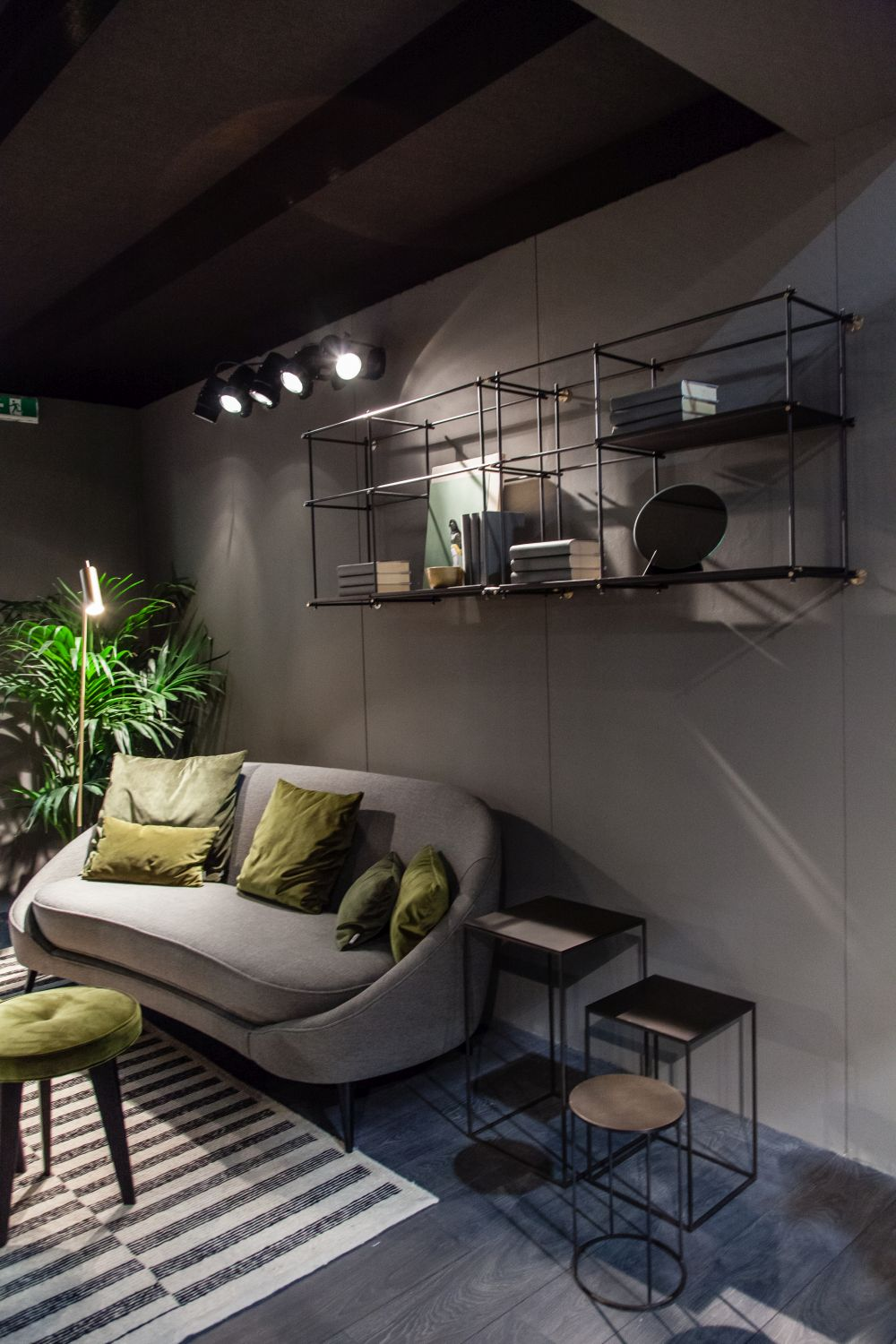 These sleek wire shelves have a chic industrial look and maintain an open and spacious feel throughout the room