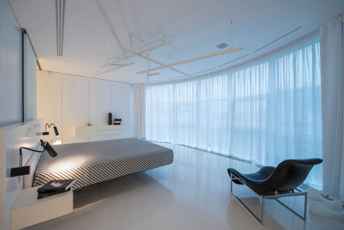 The master bedroom has panoramic views and a minimalist and breezy floor plan