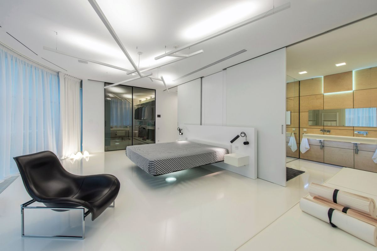 Sliding partitions allow the master bedroom and its en-suite bathroom and dressing room to come a single large space