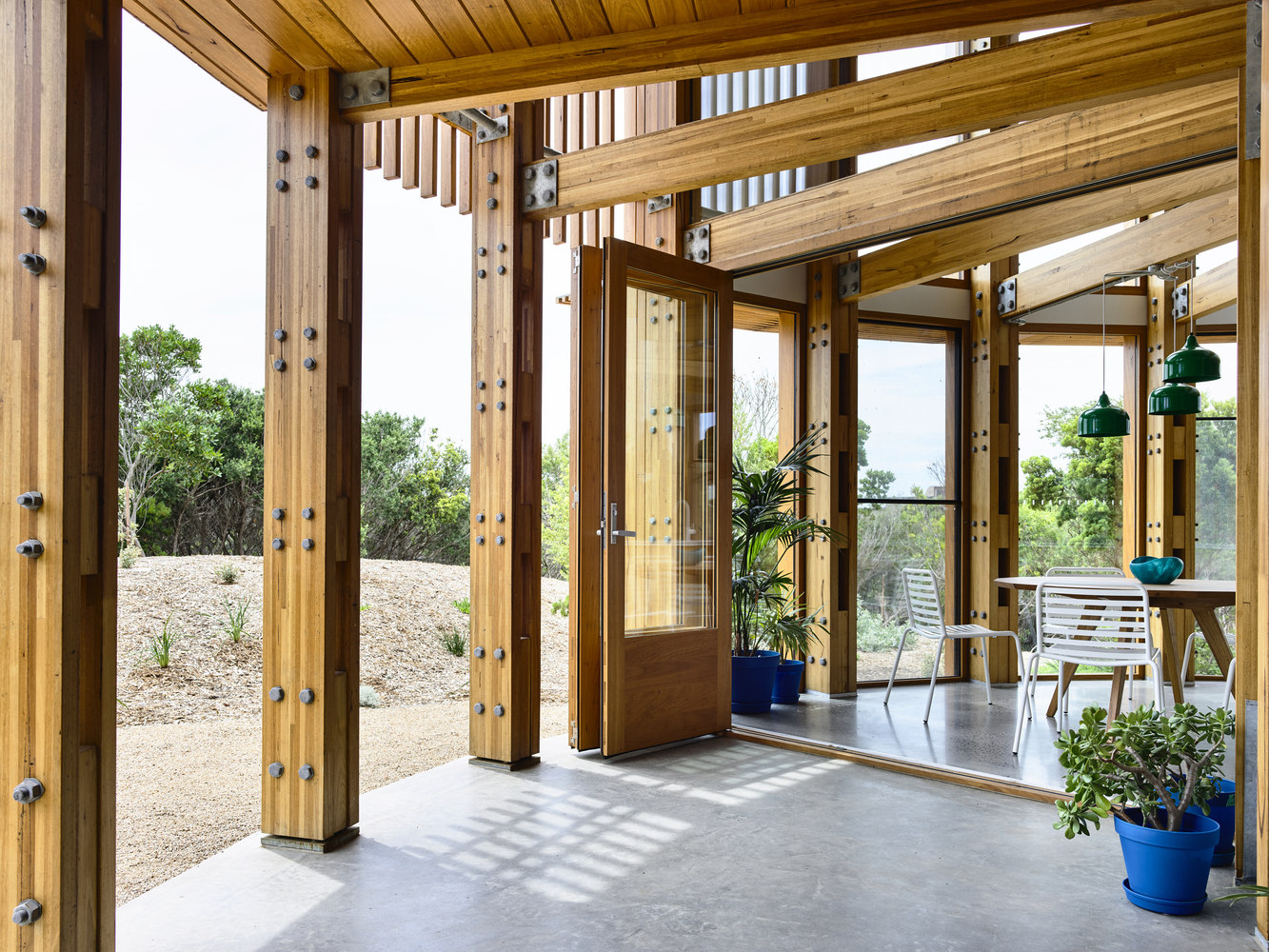 The ground floor has an open deck section with bu-fold doors and a seamless connection with the outdoors