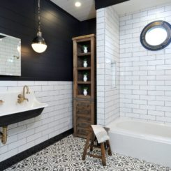 Black beadboard bathroom and brass faucet