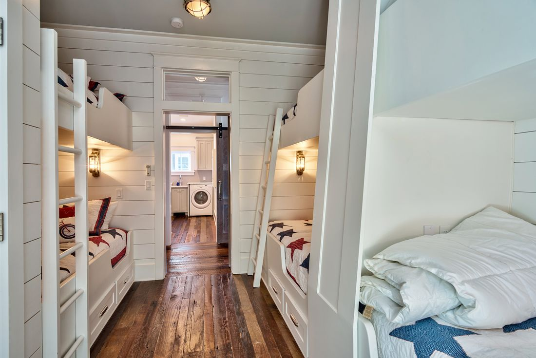 Bunk beds save space and ensure a playful and cozy ambiance in this bedroom