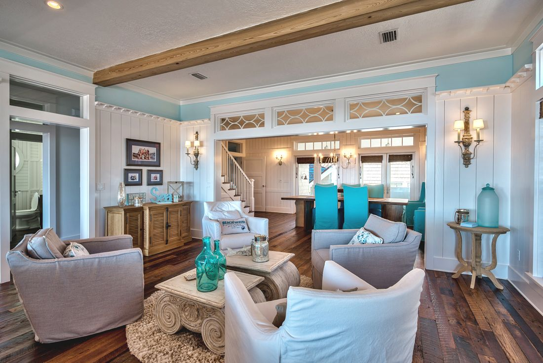Pops of turquoise give the house a fresh vibe and go beautifully with the wooden surfaces and white details