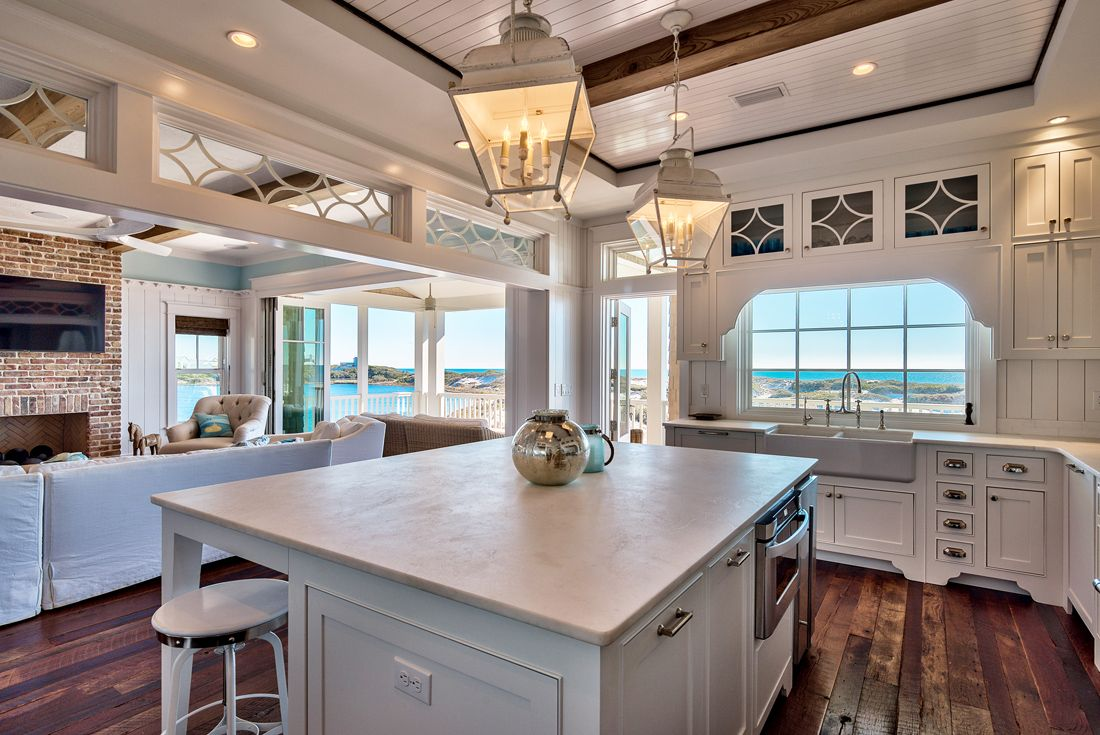 The kitchen is big and spacious, featuring a large island with seating on one side