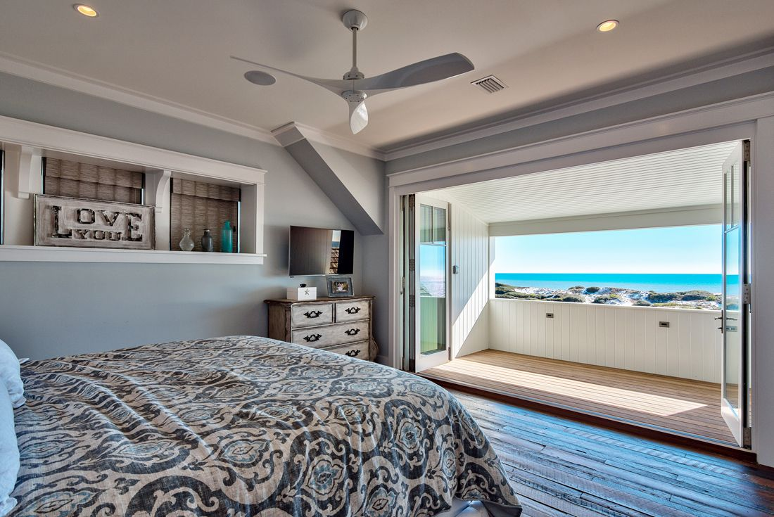 The master bedroom opens up to a balcony with a gorgeous view of the golf