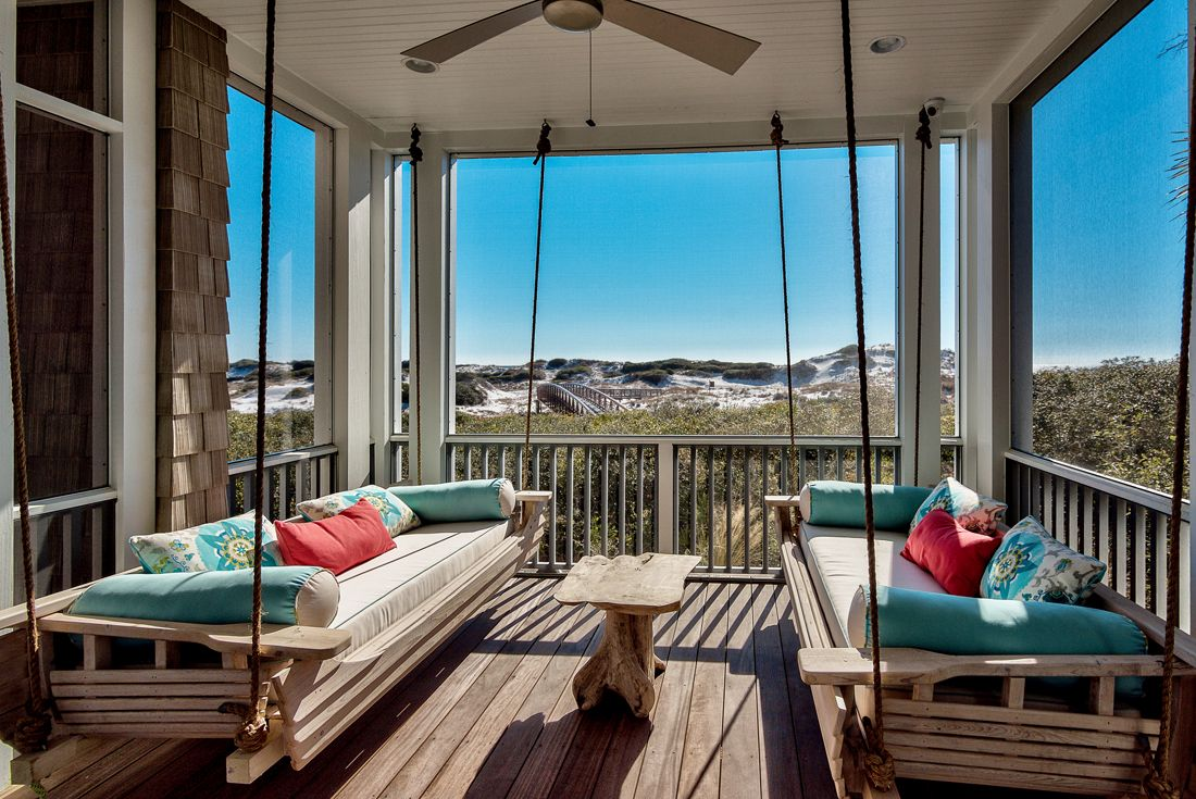 A set of hanging daybeds out on the porch create the perfect spot from where to enjoy the magnificent views