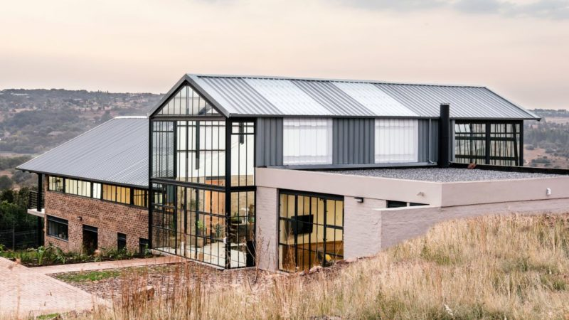 Cool House Features A Large Conservatory Volume At Its Core