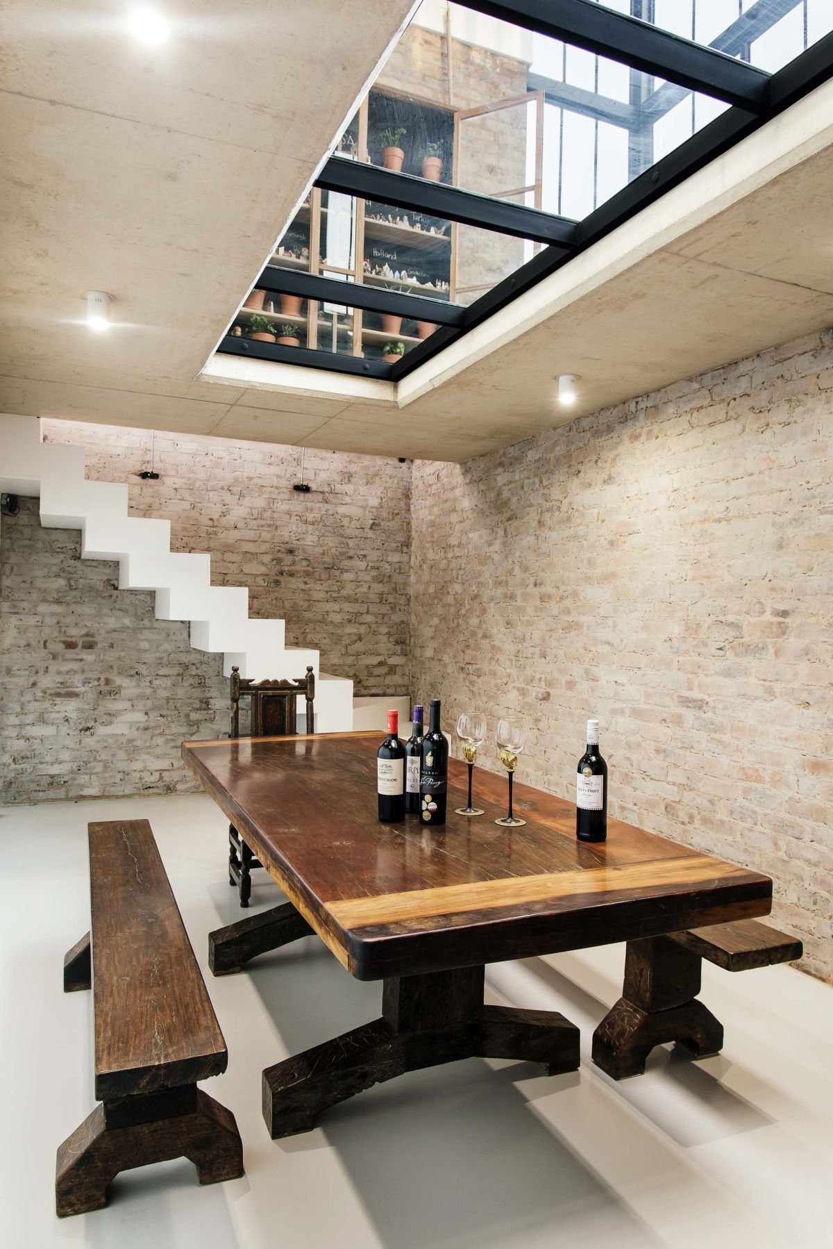 A secret staircase in the kitchen offers access to the underground wine cellar and a glass floor panel connects the two levels