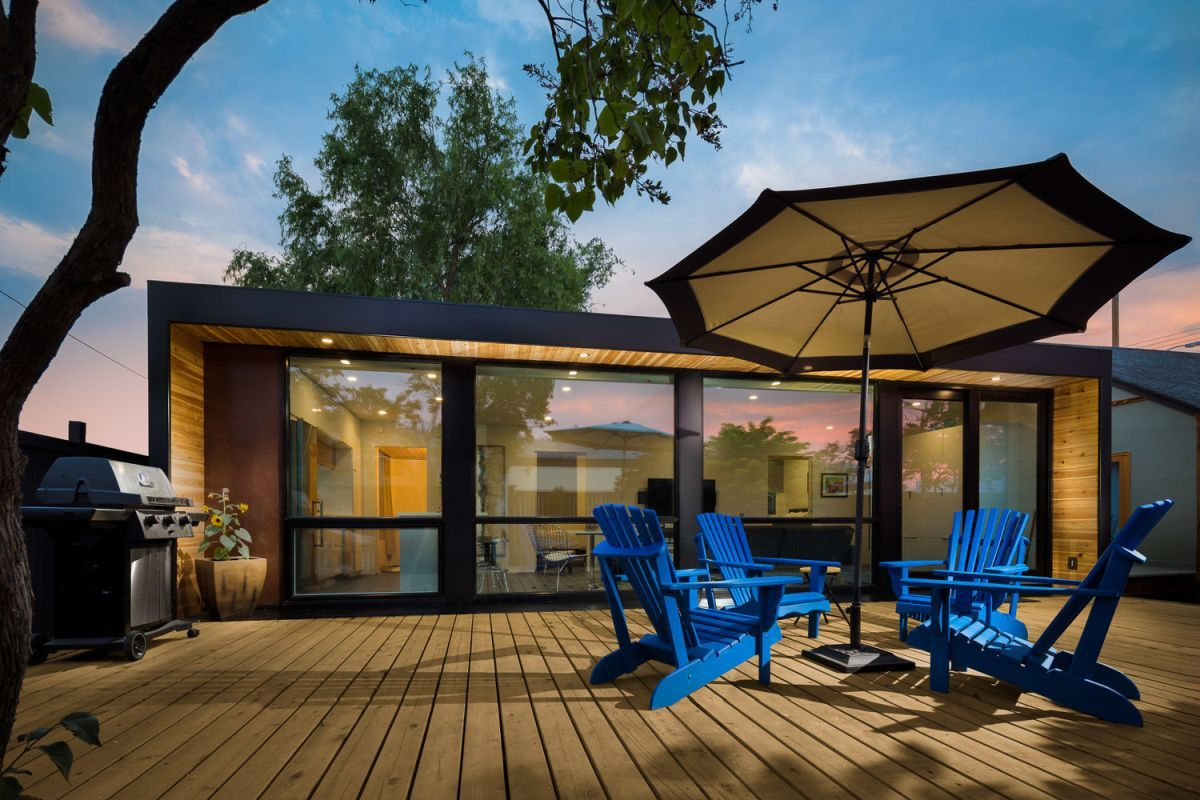 The patio wood ties together the container house and the outdoor space.