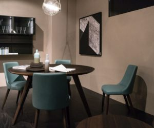 Dining room featuring a round table and leather chairs