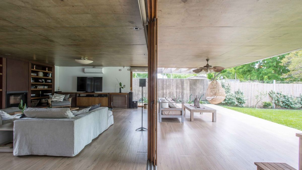 The social areas are seamlessly connected to covered patio spaces which in turn open up to the backyard