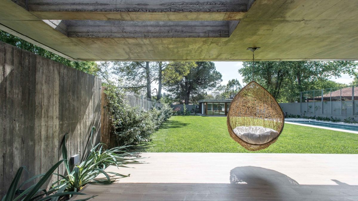 The open patio acts as a transition space between the indoor and the outdoor
