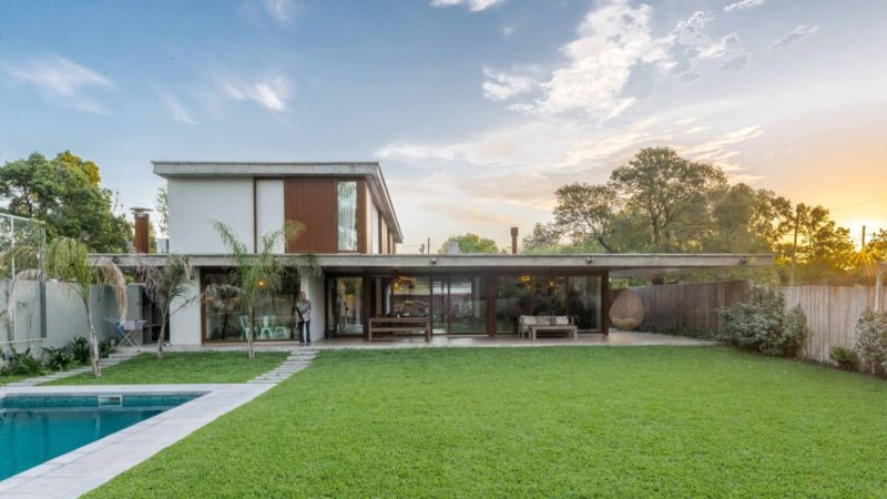 Contemporary Concrete House Takes Advantage Of A Small Corner Lot
