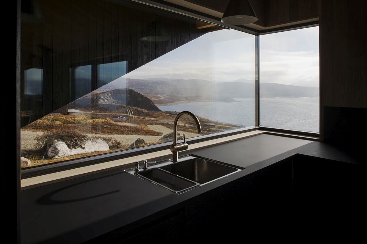 The orientation of the cabin maximizes the views of the lake and the surrounding wild landscape