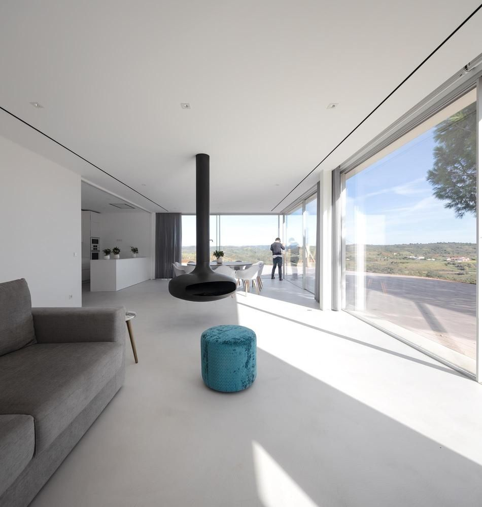 The internal spaces are bright and open, with full-height windows and minimal obstructions