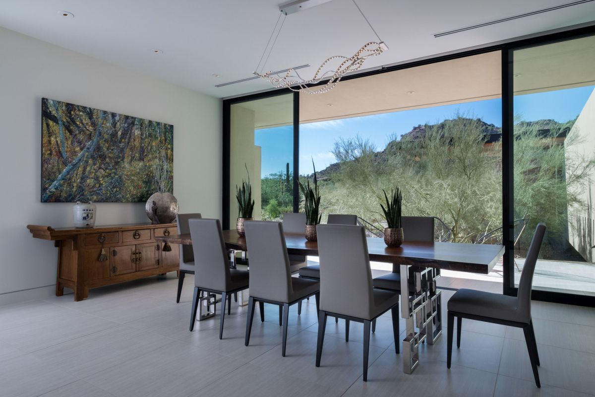 Sliding glass doors and full height windows bring the views and nature itself into the house