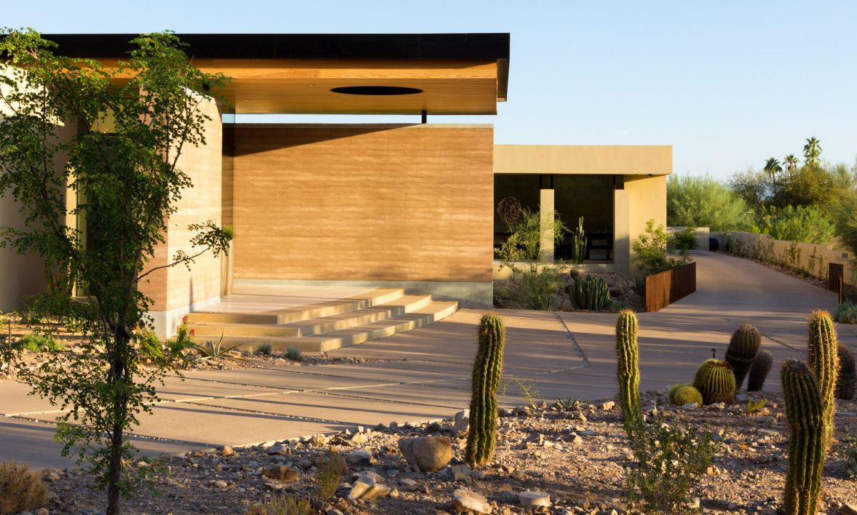 The house was built using local materials and features rammed earth walls and a wooden roof structure