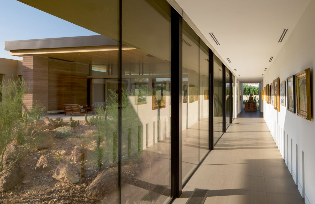 Large expanses of glass allow tons of natural light to enter the house, illuminating all the rooms