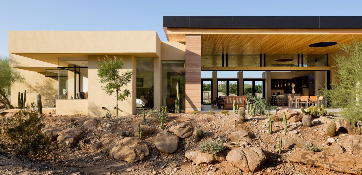 This is a desert house designed to serve as a cozy family home in sync with its surroundings