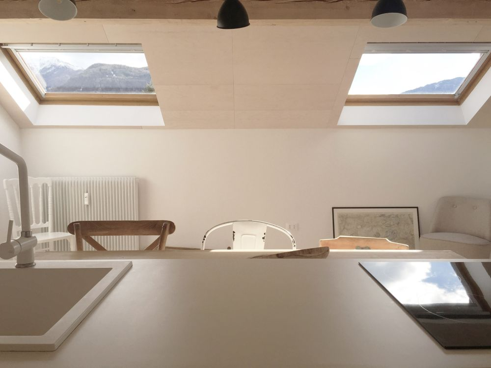 The angled skylights bring in lots of sunlight and also frame some nice views of the mountains