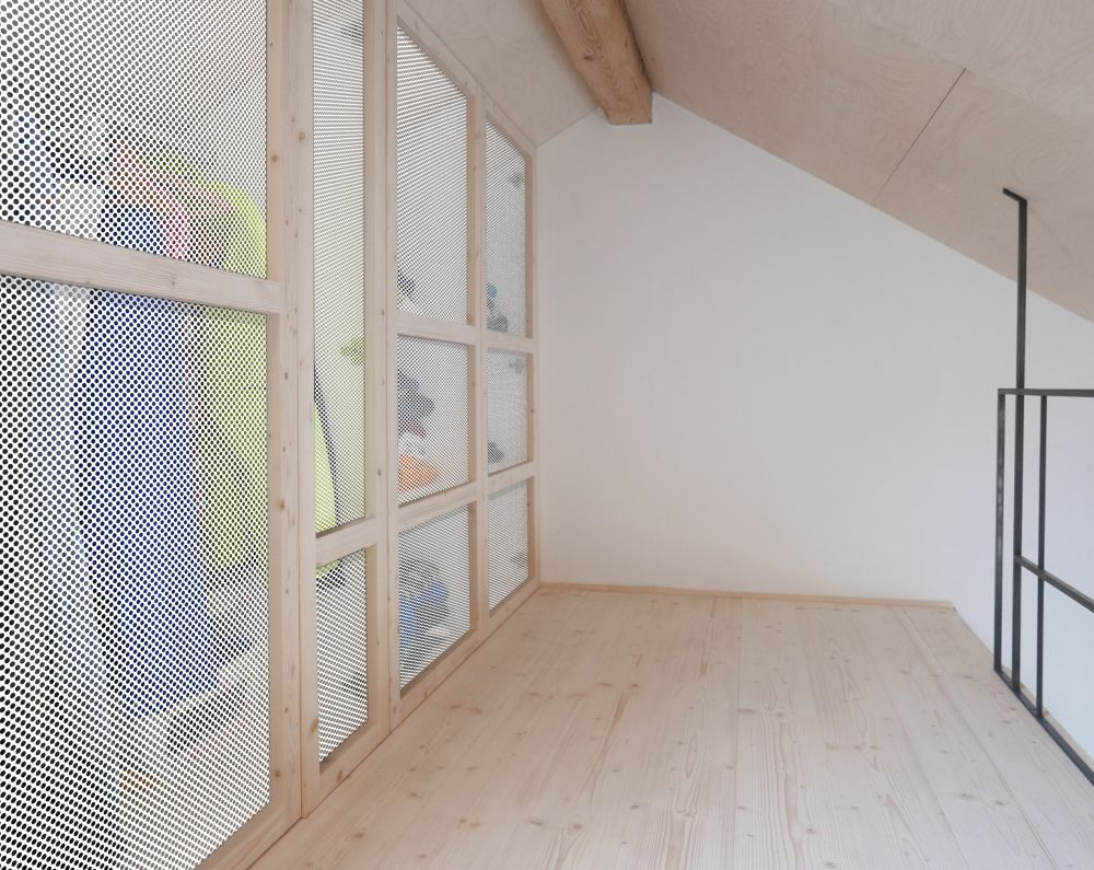 the mezzanine bedroom has a large closet space with mesh screens which let you see through