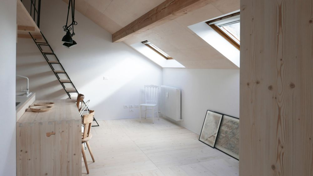 The mansard roof creates a cozy vibe inside the apartment, similar to what an attic space would offer