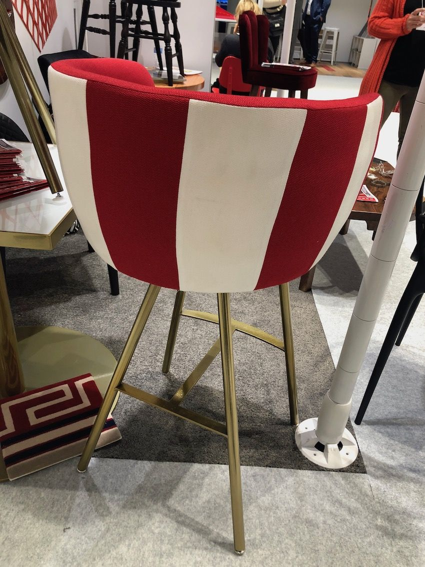 Wide stripes including a bold red make a sleek chair special.