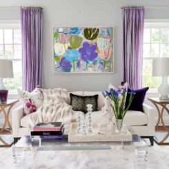 Living room with modern furniture and purple curtains