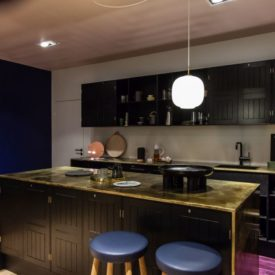 Modern kitchen with hanging pendant fixture