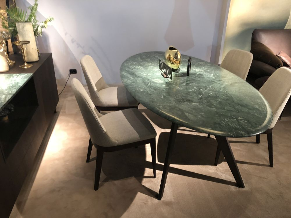 You can add a sophisticated touch to the dining room by incorporating materials such as marble or stone in the design
