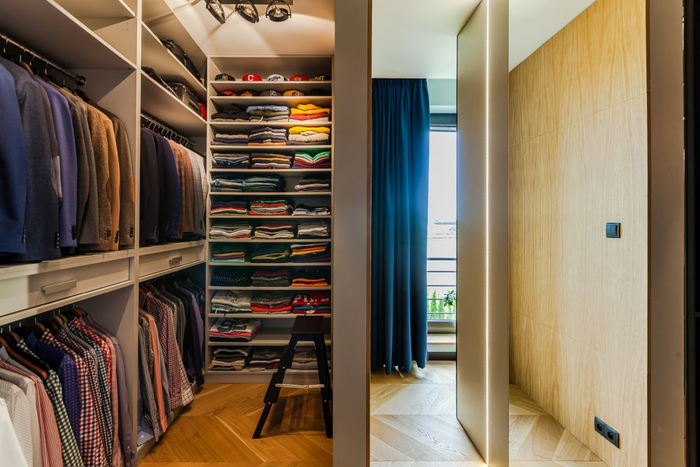 The master bedroom suite has a walk-in closet with carefully-planned storage systems which eliminate clutter