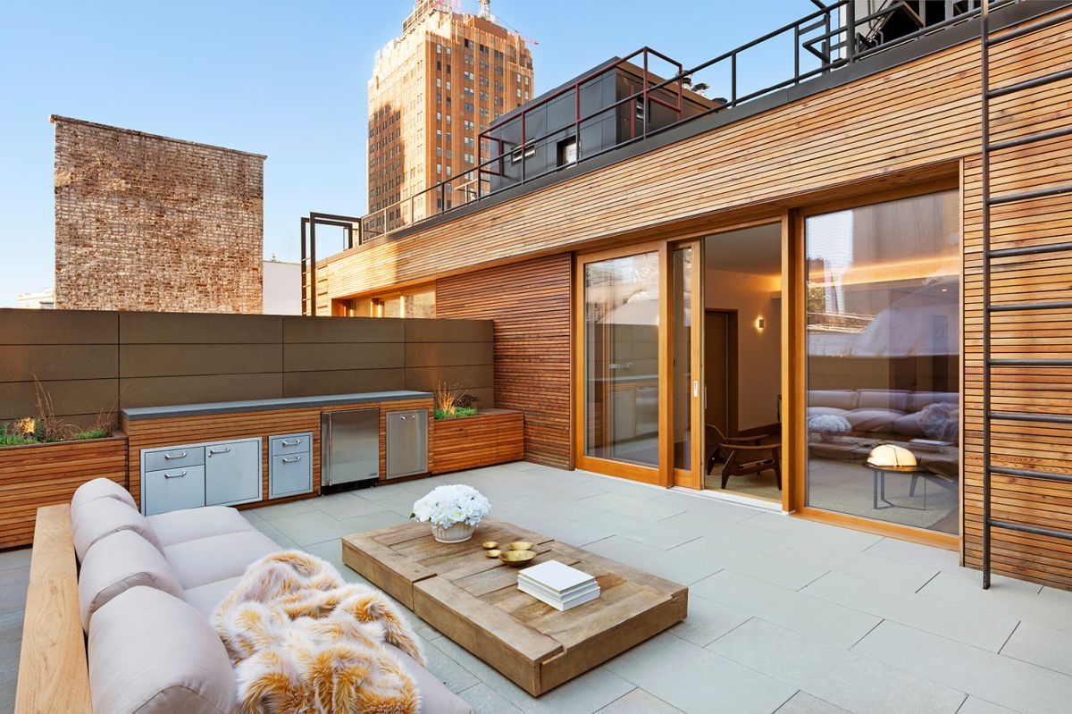 A rooftop patio is a private oasis.