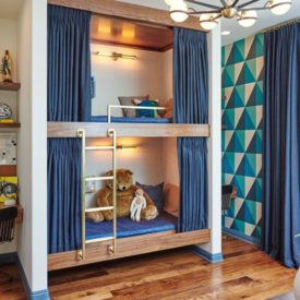 Small bunk beds with a built in layout and brass ladder