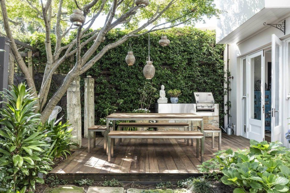 Lots of greenery and some Asian elements create a Zen patio.