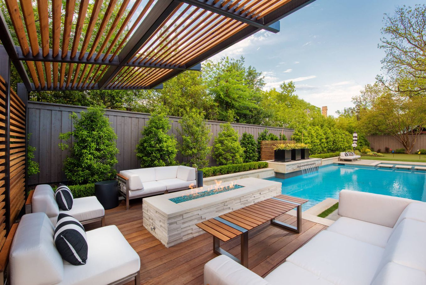 A mix of modern and contemporary pieces decorate this poolside patio.