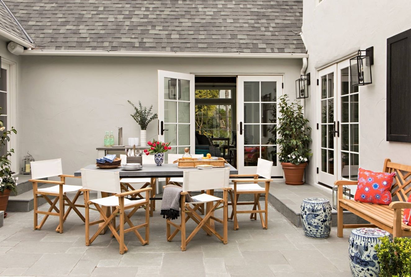A patio courtyard is done in transitional style.