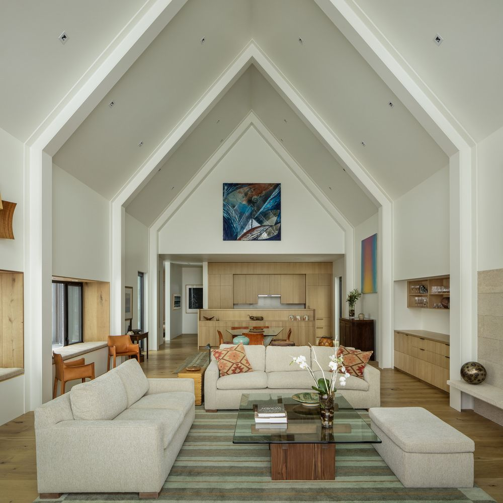 The interior spaces have tall pitched ceilings which create a very airy and at the same time warm and cozy vibe
