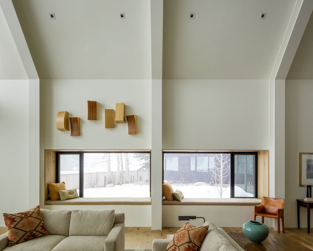 The windows are positioned low on the walls and feature seating nooks which suit the rooms wonderfully