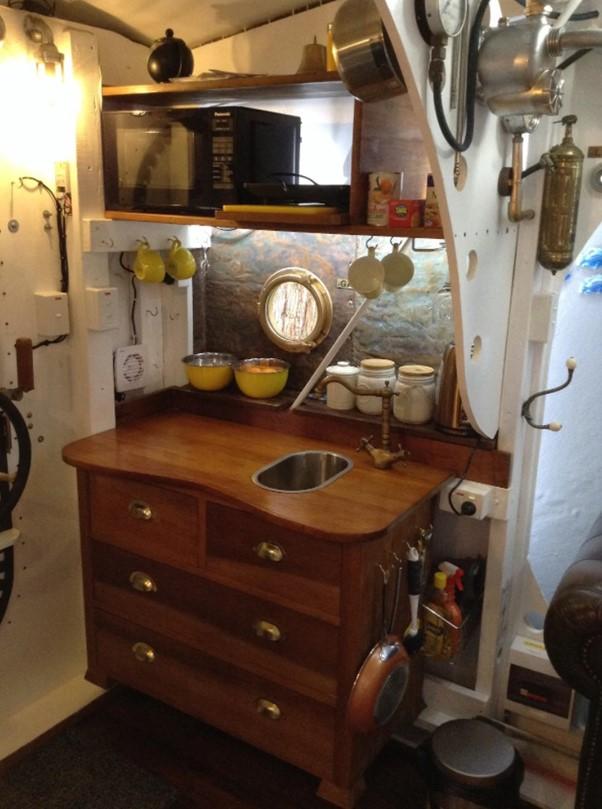 Yellow submarine tiny house interior kitchen