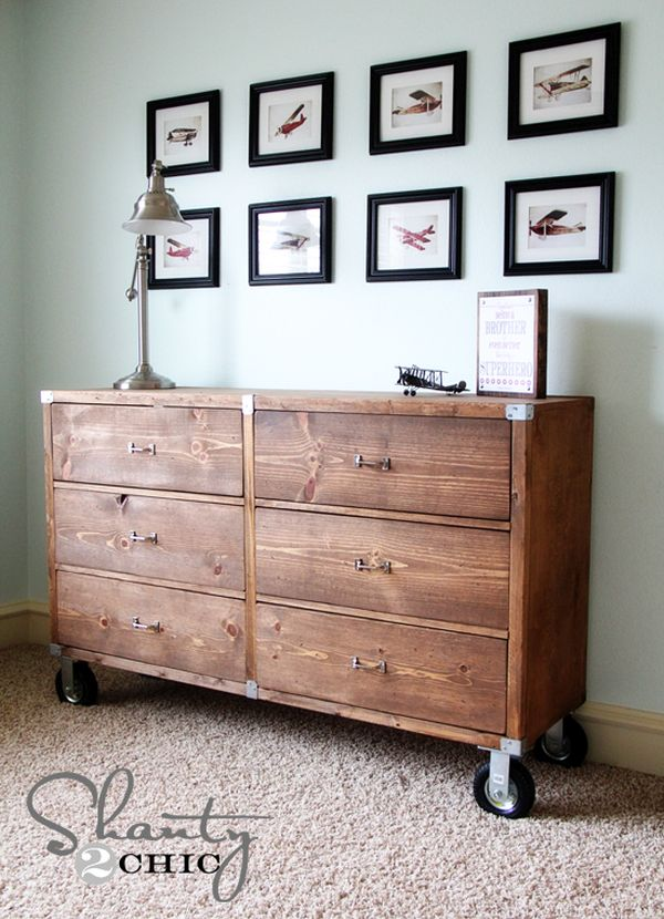 A rustic chest of drawers on wheels